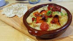 Smoked Milkfish Brandade with Roasted Cherry Tomatos and Savory Piaya Flatbread.